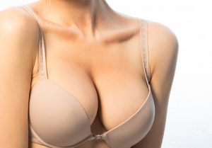 Female breast in a beige bra